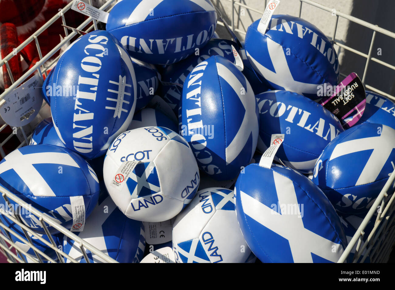 Novelty small Scotland rugby balls on display outside of a souvenir shop on the Royal Mile, Edinburgh. - Stock Image