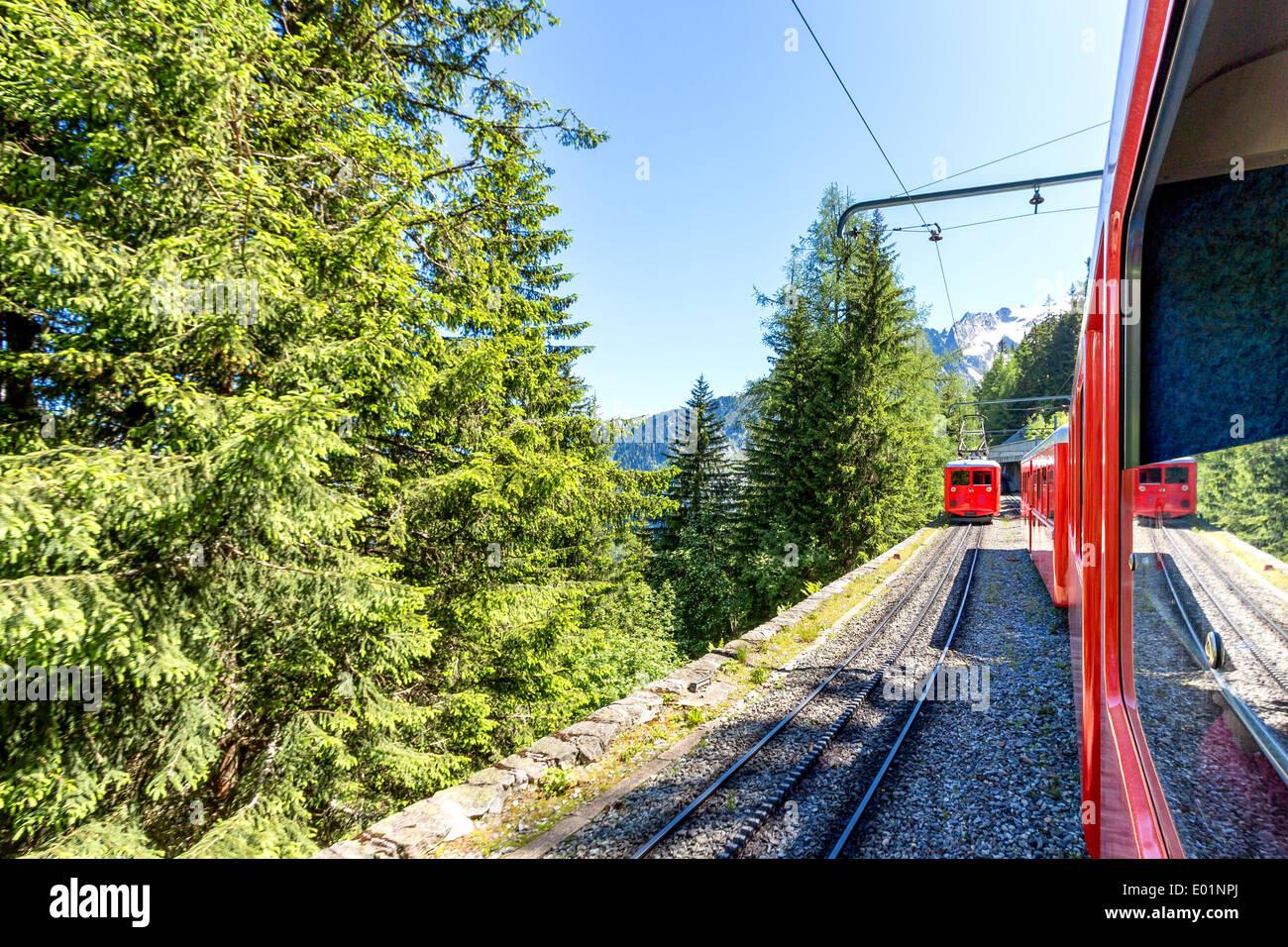 Meeting cog wheel trains on a railway between Montevers and Chamonix (heading towards Mer de Glace glacier), France, EU - Stock Image