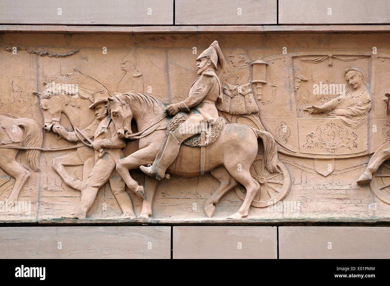 London, England, UK. No1 Poultry (James Stirling, 1994) historical frieze on the facade: royal procession - Queen Victoria - Stock Image