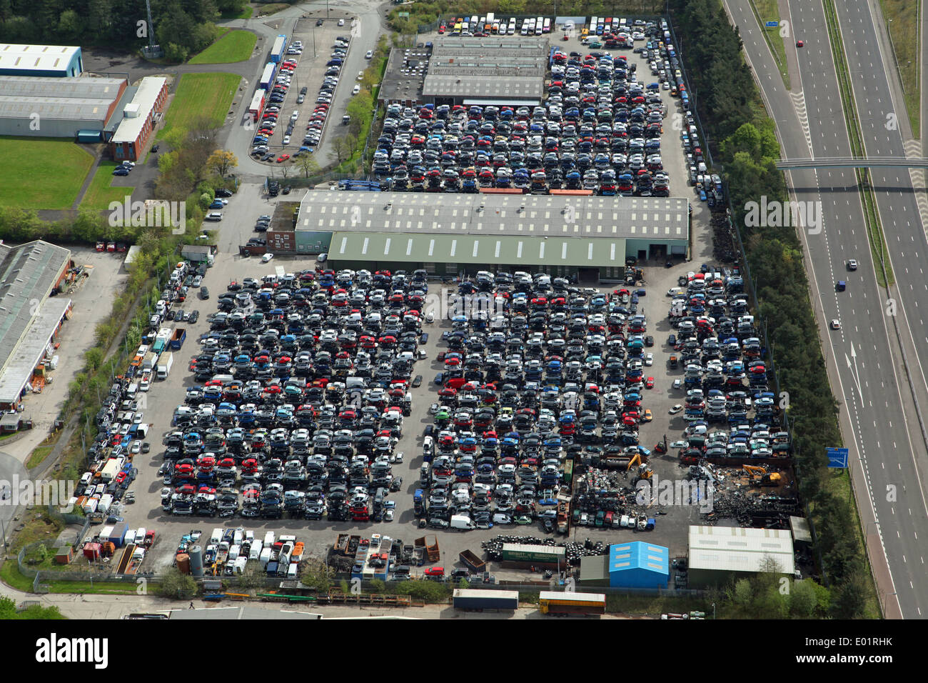 aerial view of a large car scrapyard next to the M58 at Skelmersdale, Lancashire - Stock Image