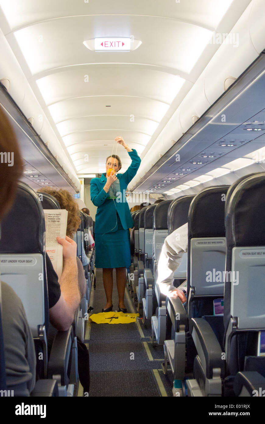 Aer Lingus cabin crew safety demonstration with oxygen mask - Stock Image