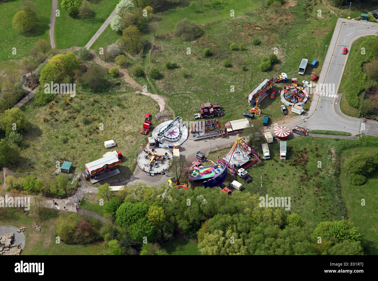 aerial view of a fun fair set up on waste ground at Skelmersdale, Lancashire - Stock Image