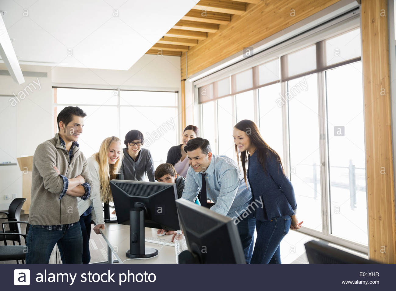 High school students and teacher in computer lab - Stock Image