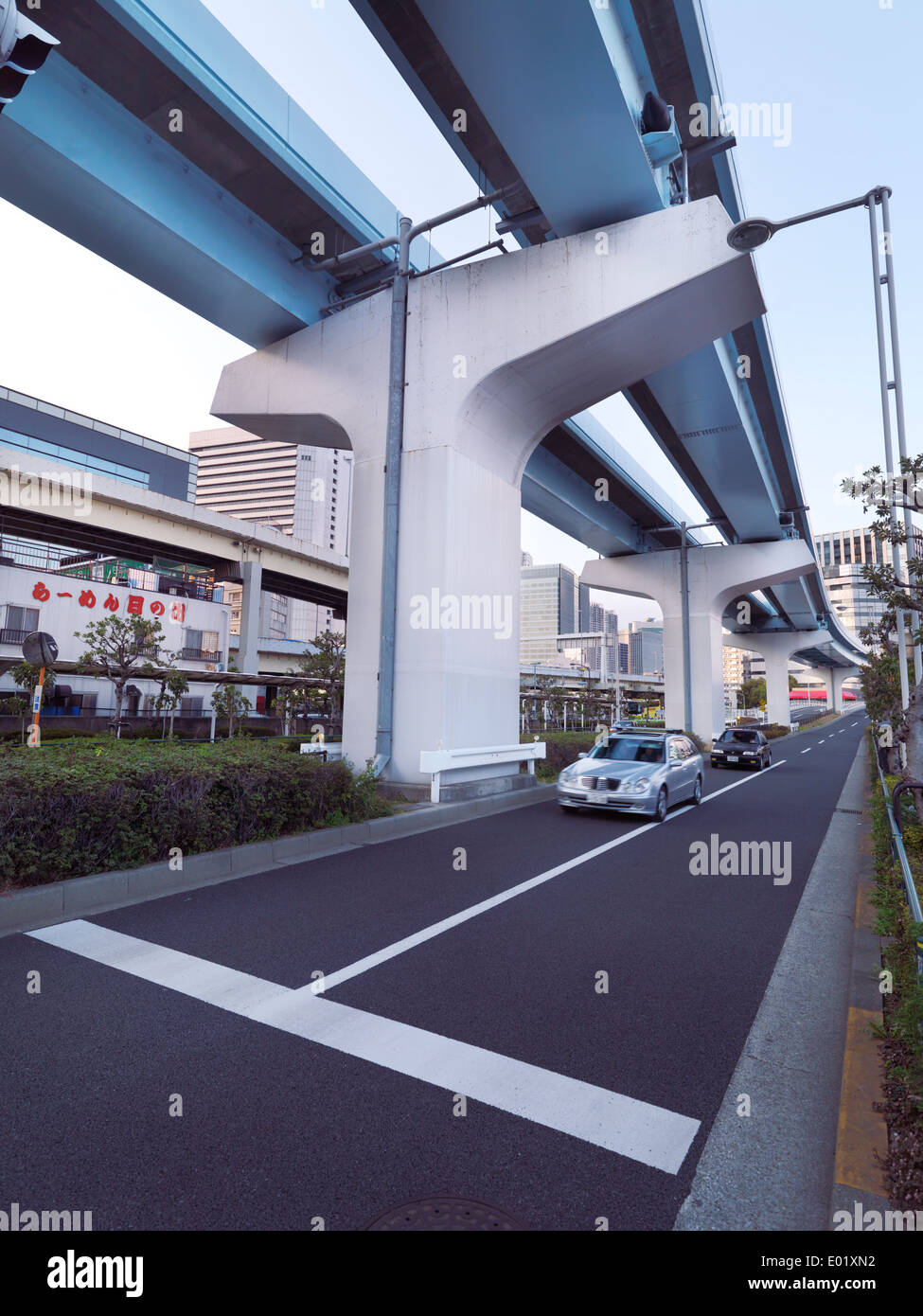 Elevated train line New Transit Yurikamome above street in Tokyo, Japan. - Stock Image