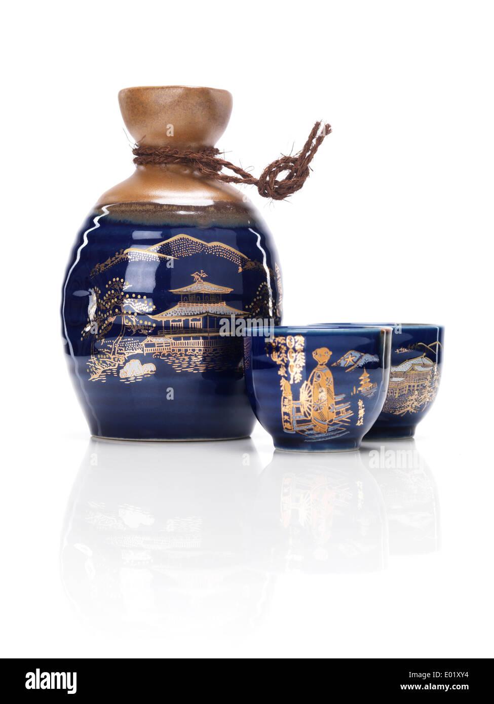 Japanese souvenir sake set, bottle tokkuri and cups ochoko isolated on white background - Stock Image