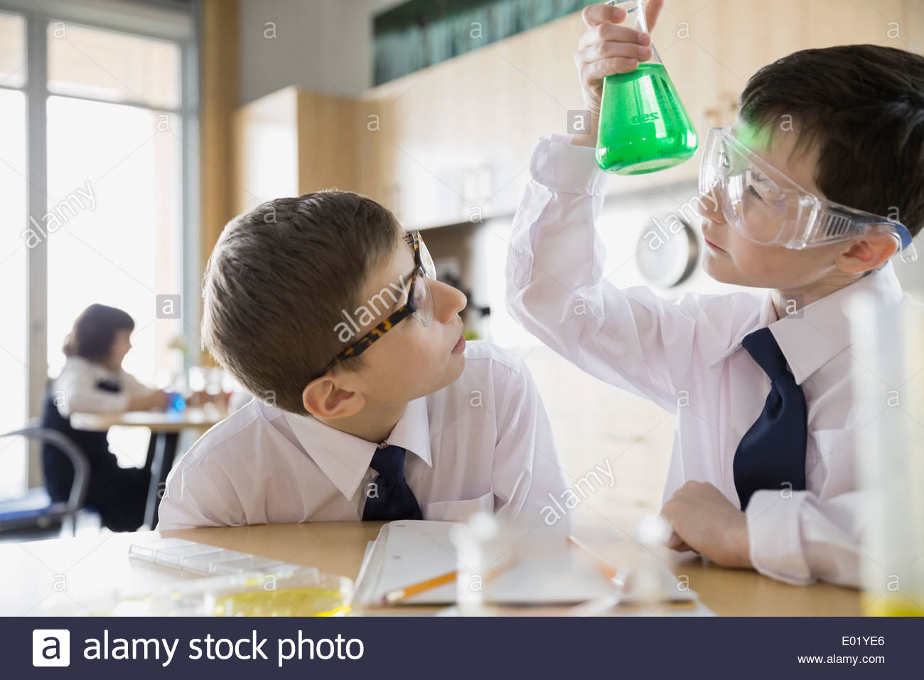 School boys conducting experiment in science classroom - Stock Image