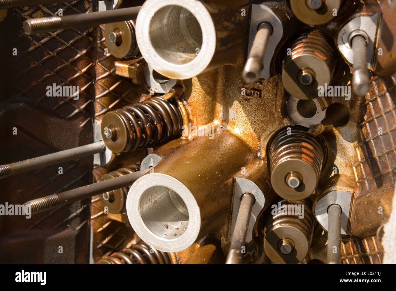 A close up of a head off a internal combustion engine including valve springs Stock Photo
