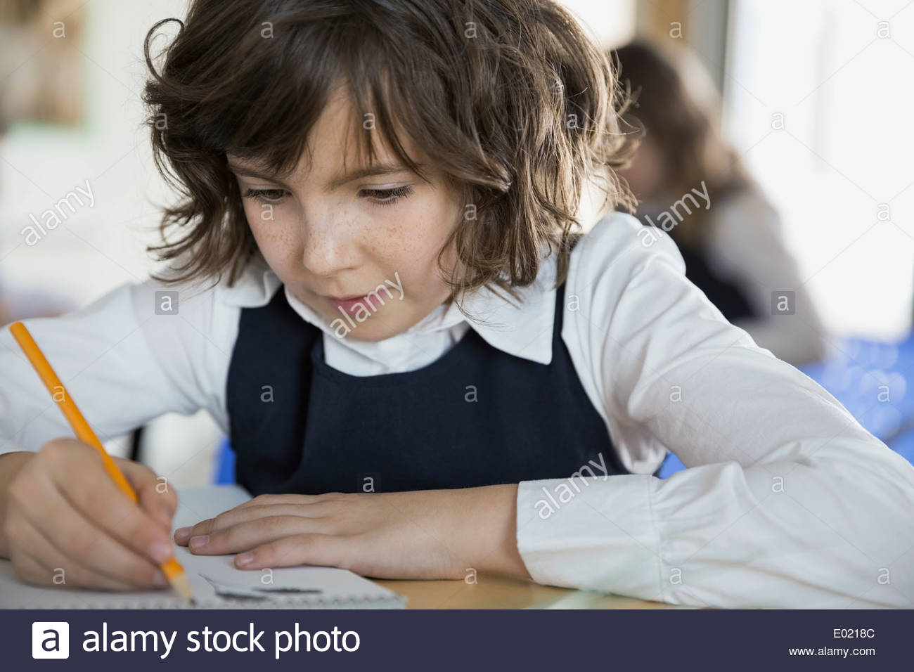 Close up of school girl doing homework - Stock Image