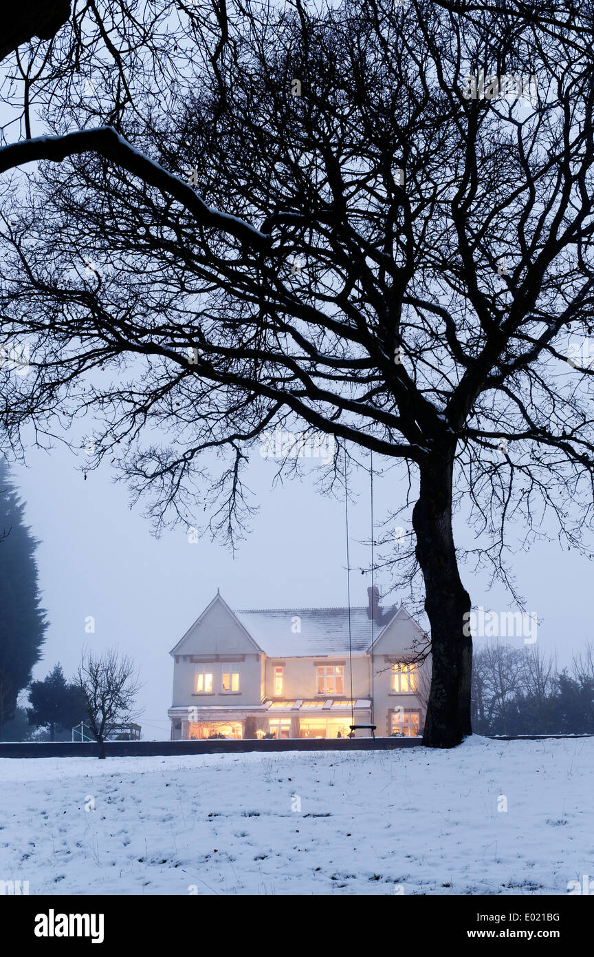 External facade of snow capped late Victorian house, Dorset - Stock Image