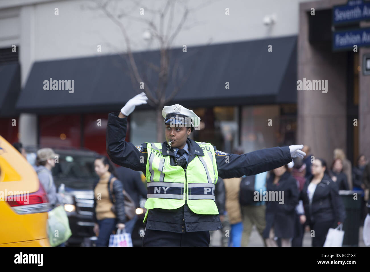 You have to keep your cool to be a traffic cop at 34th & Broadway by Macy's in NYC. - Stock Image