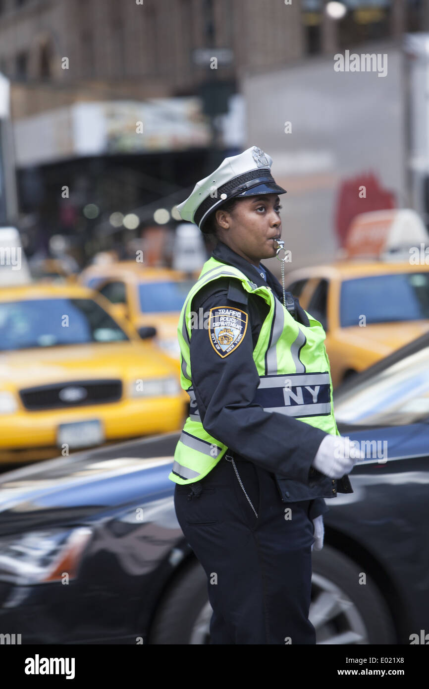 You have to keep your cool to be a tgraffic cop at 34th & Broadway by Macy's in NYC. - Stock Image