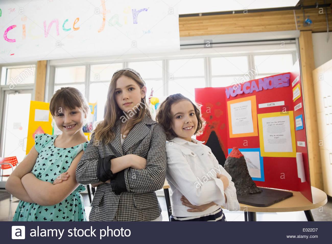 Portrait of confident school girls at science fair Stock Photo