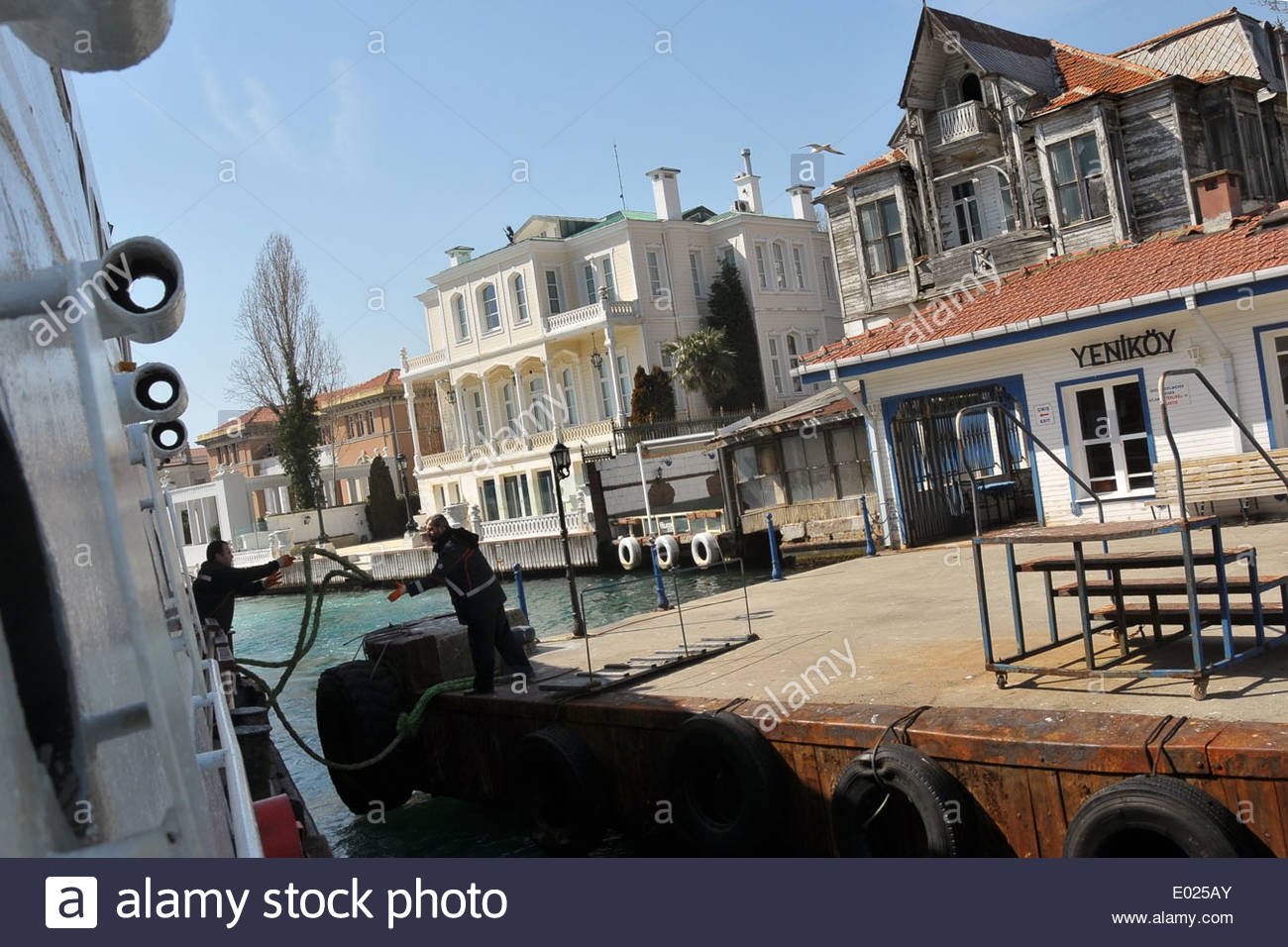 An Istanbul ferry boat is mooring at the ferry station pier in Yeniköy on the European side of the Bosphorus - Stock Image