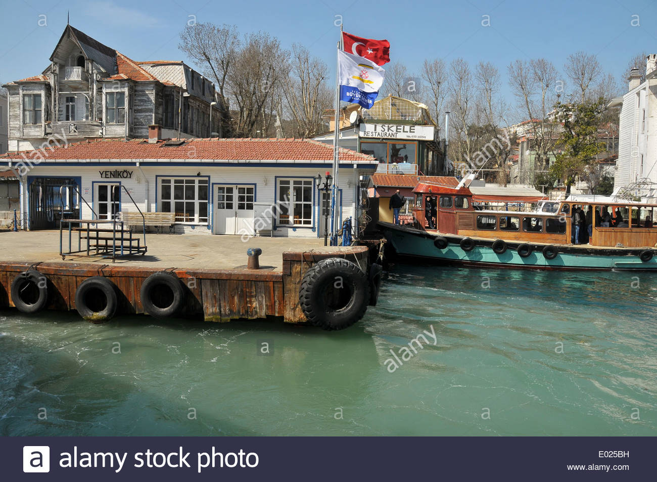 The ferry boat station at Yeniköy on the European side of the Bosphorus. - Stock Image