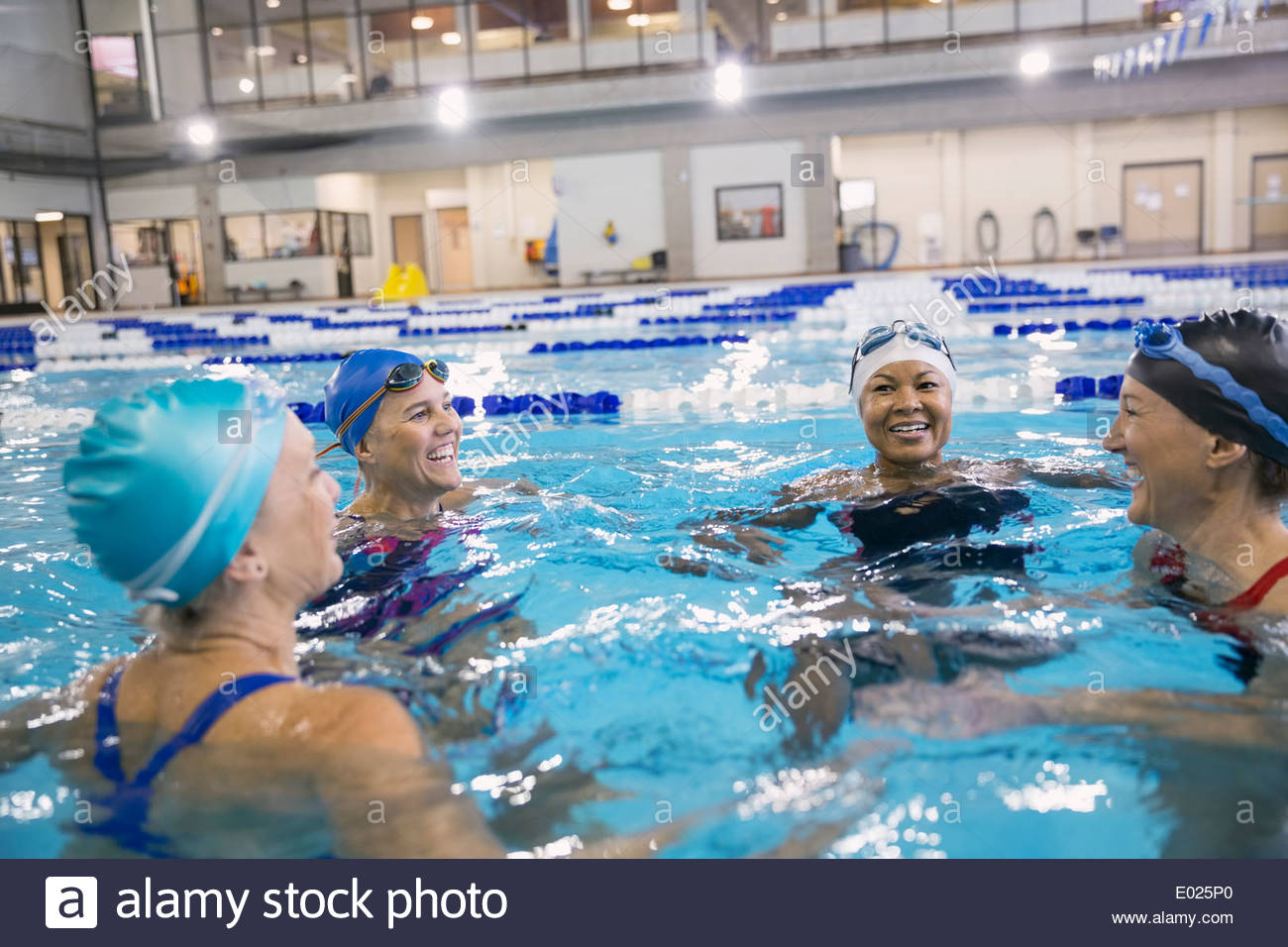 Women in indoor swimming pool - Stock Image