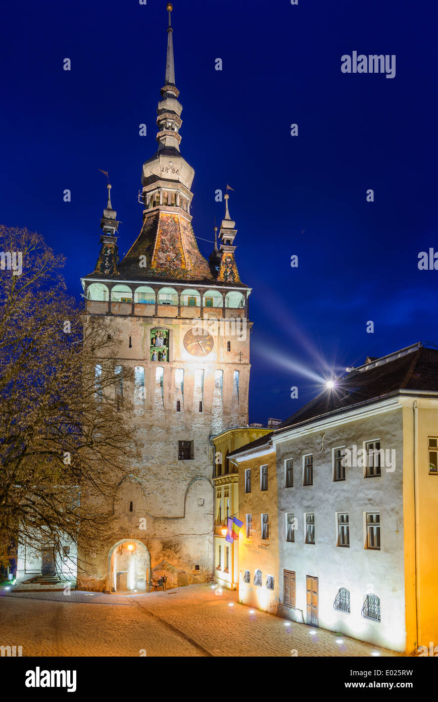 clock tower in historic center of sighisoara, transylvania, romania at night Stock Photo