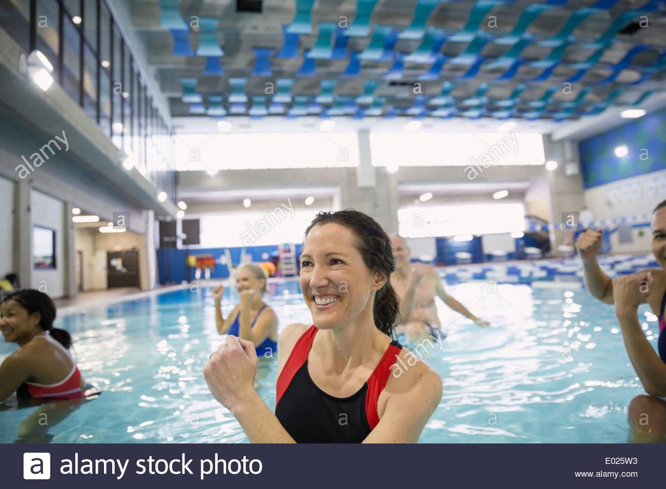 Water aerobics class at indoor swimming pool - Stock Image