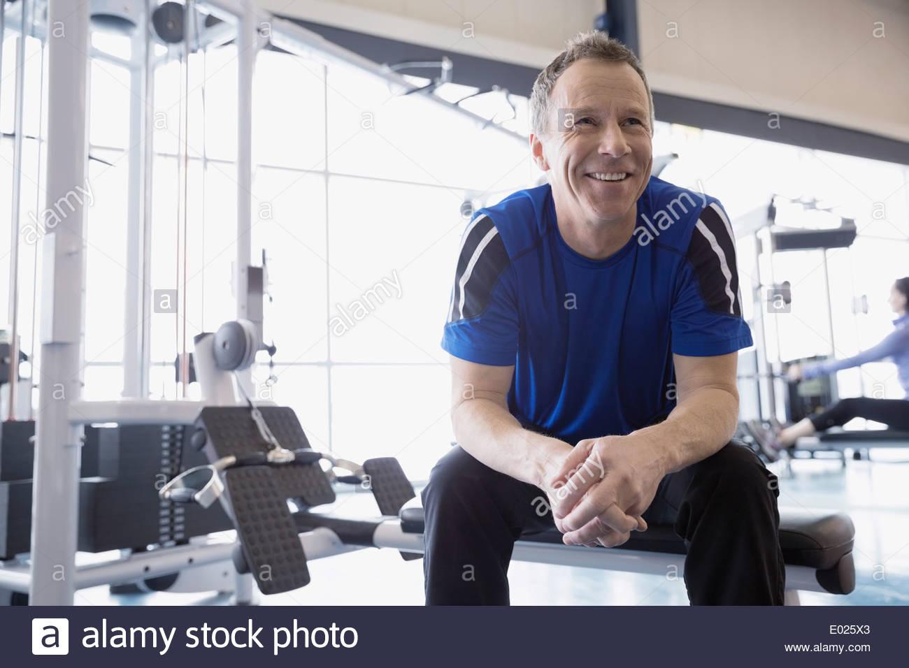 Smiling man resting at gym - Stock Image