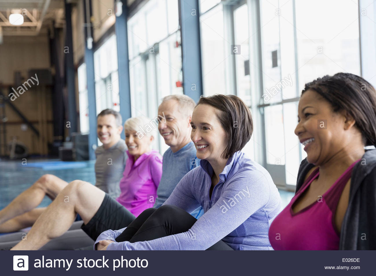 Smiling group in exercise class at gym - Stock Image