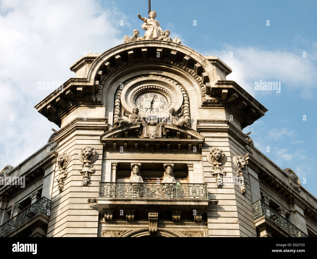 Old building and its clock in downtown Mexico City - Stock Image