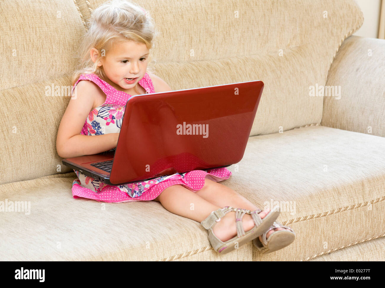 young girl using laptop computer - Stock Image