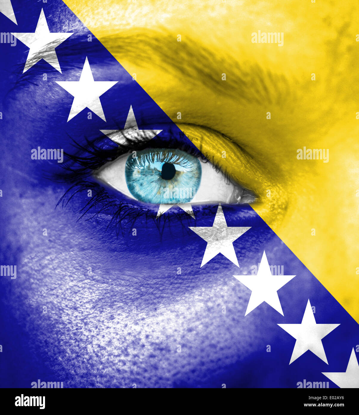 Woman face painted with flag of Bosnia and Herzegovina - Stock Image