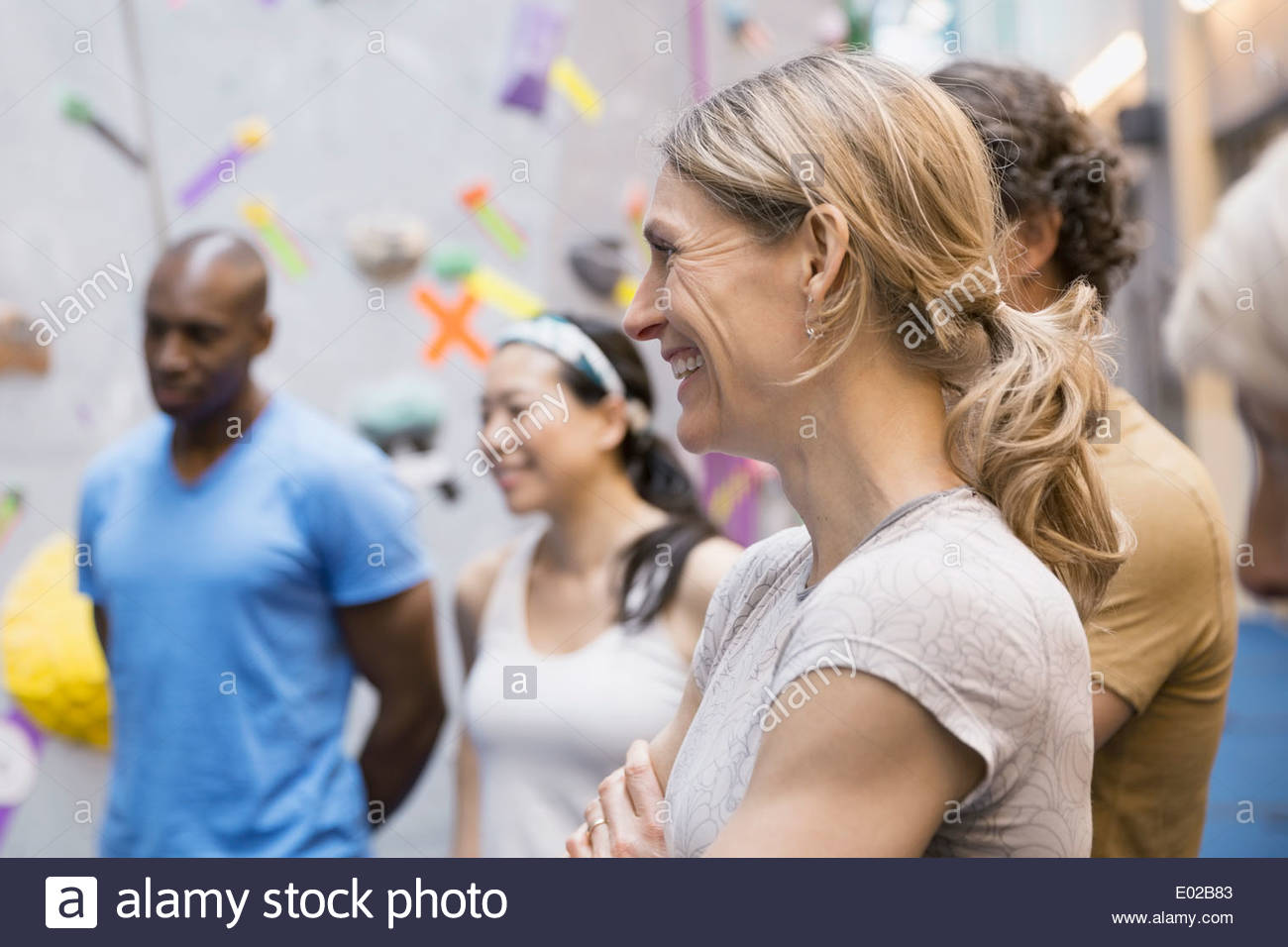 Group at rock climbing wall - Stock Image
