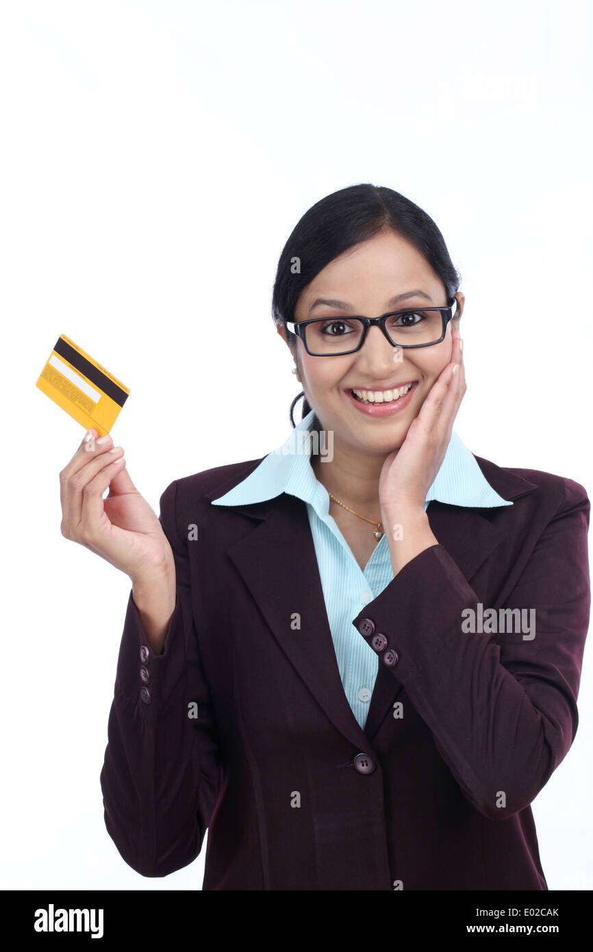 Indian lady showing credit card stock photos indian lady showing surprised young business woman with credit card against white background stock image reheart Images