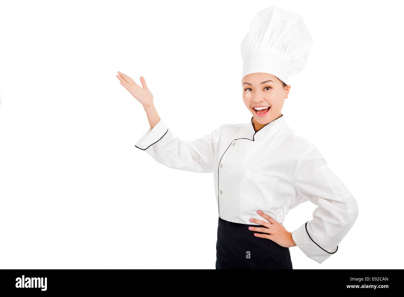 young female cook raise hands to show something - Stock Image