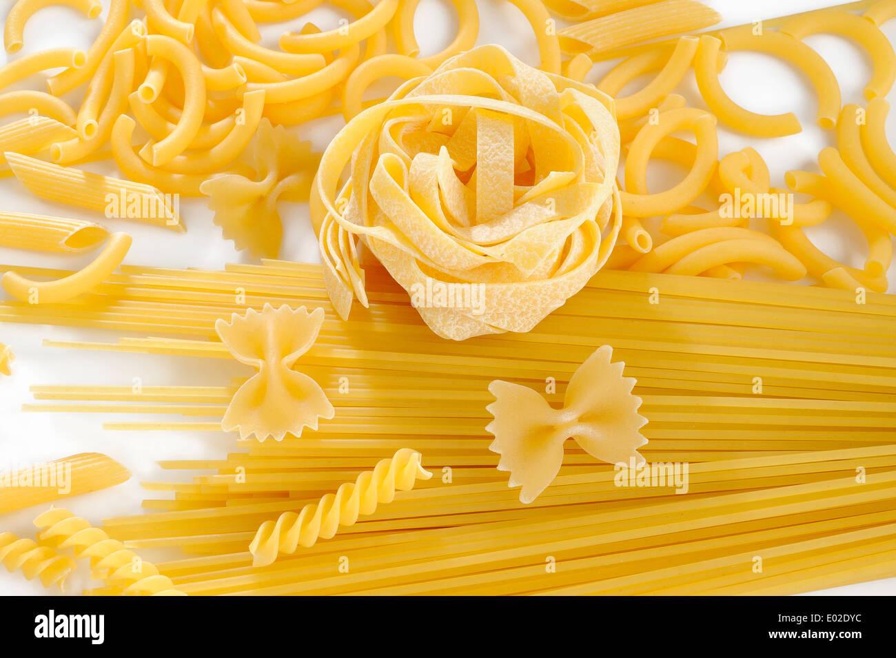 raw pasta on white background Stock Photo
