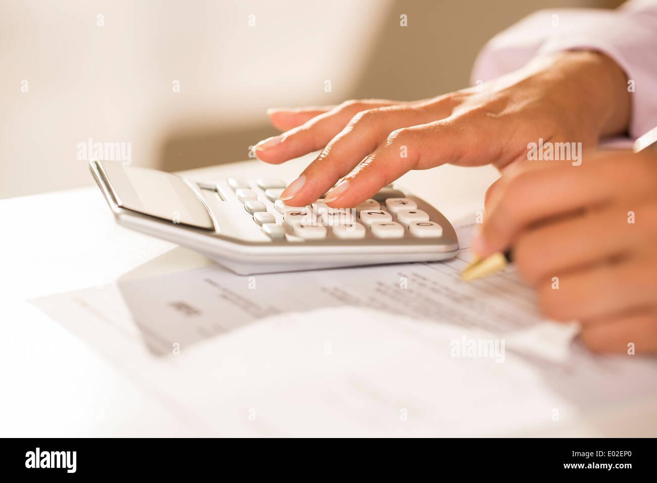 Female finger desk indoor white bill invoice - Stock Image