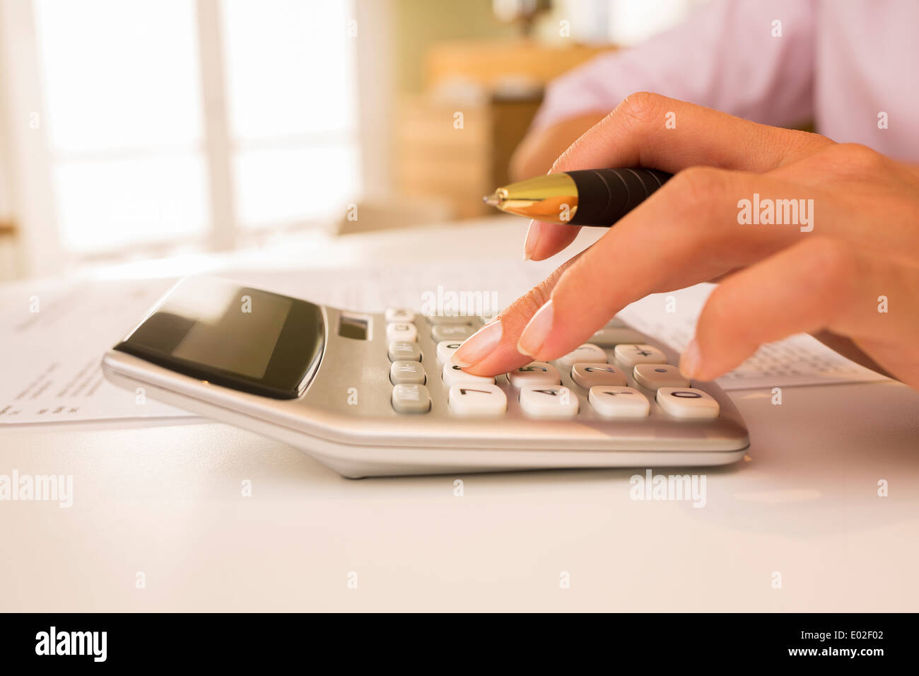 Female finger desk indoor white bill invoice - Stock Image