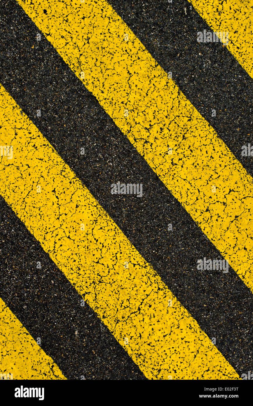 yellow striped road markings on black asphalt highway no parking is