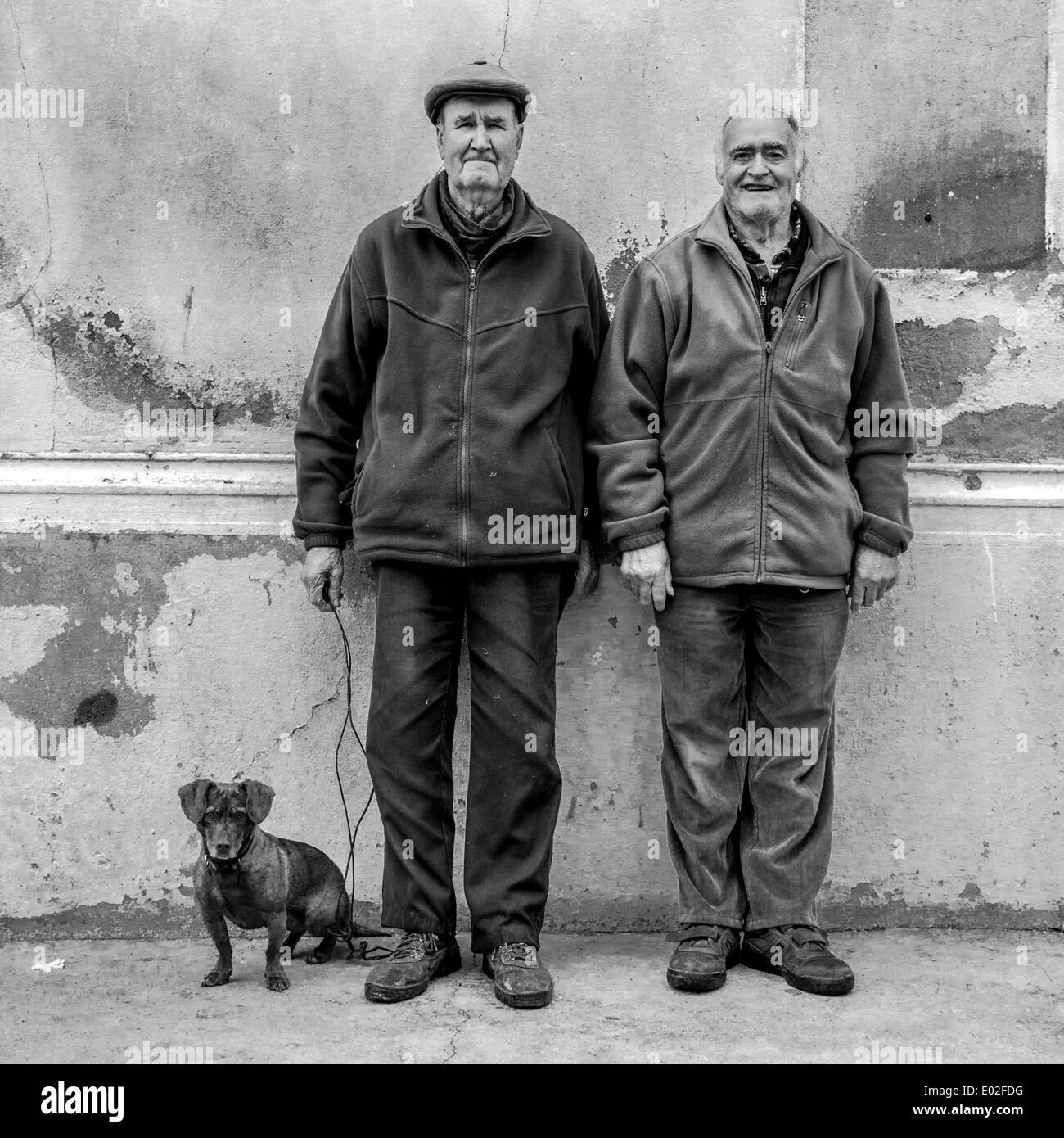 Two old men with a Dachshund, Spain - Stock Image