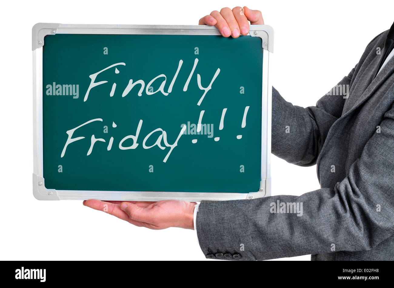 a businessman holding a chalkboard with the text finally friday written in it Stock Photo