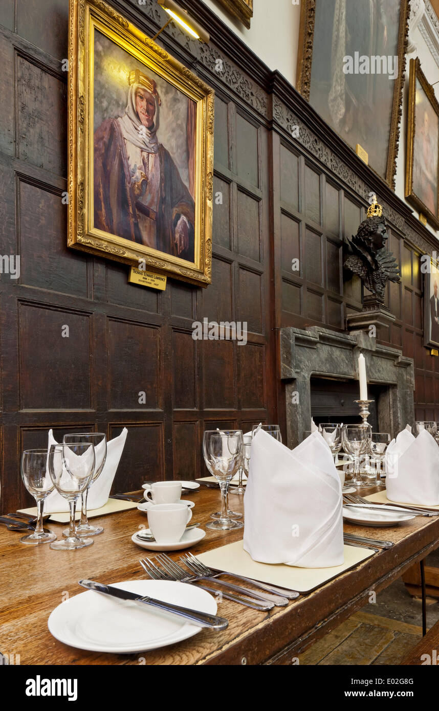 Jesus College Oxford, Oxford, United Kingdom. Architect: N/A, 1571. Dining Hall laid out for banquet with portrait of T E Lawren - Stock Image