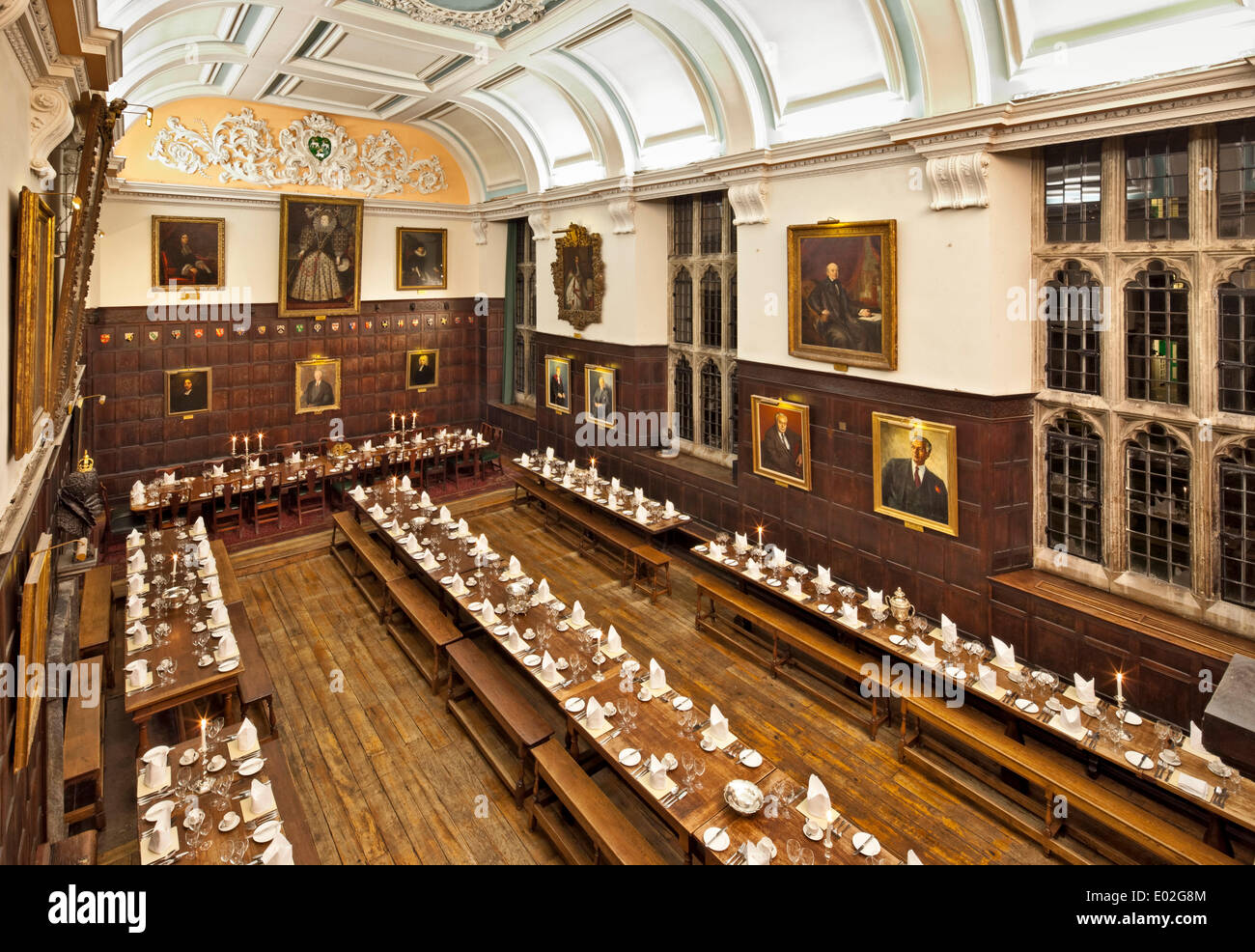 Jesus College Oxford, Oxford, United Kingdom. Architect: N/A, 1571. Dining Hall laid out for banquet with candle light. - Stock Image