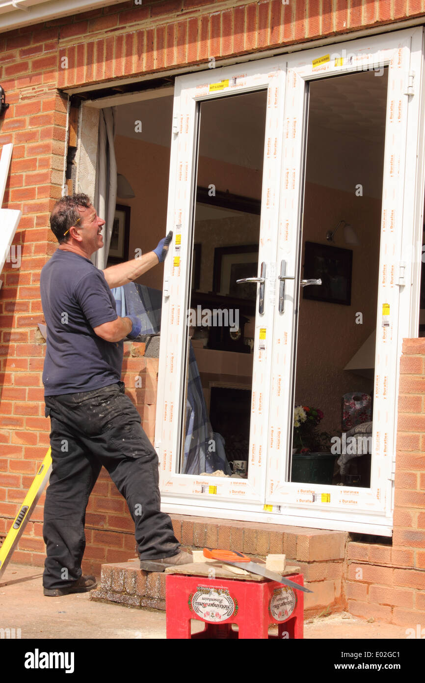 Installation of new plastic doors and windows to a bungalow & Installation of new plastic doors and windows to a bungalow Stock ...