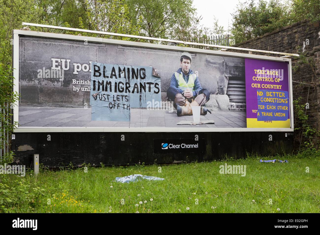 Swansea, UK. 30th Apr, 2014. UKIP Campaign Poster defaced in Swansea ahead of party leader Nigel Farage's visit to the city today. Credit:  John Wellings/Alamy Live News - Stock Image