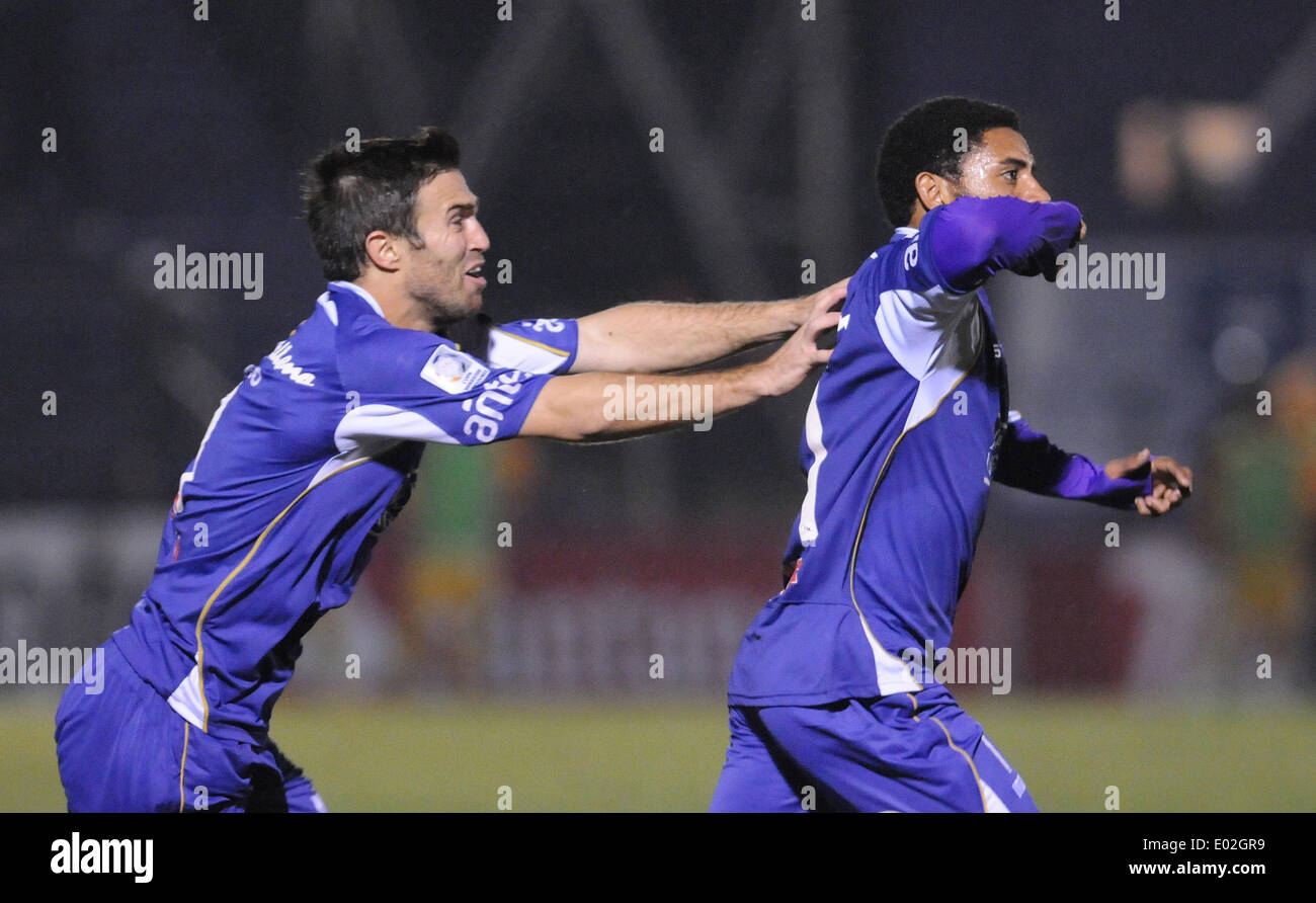 Montevideo, Uruguay. 29th Apr, 2014. Nicolas Olivera (R) and Matias Alonso of Uruguay's Defensor Sporting celebrate scoring against Bolivia's the Strongest during the knockout stage match of Libertadores Cup held at Luis Franzini Stadium in Motevideo, Uruguay, on April 29, 2014. © Nicolas Celaya/Xinhua/Alamy Live News - Stock Image