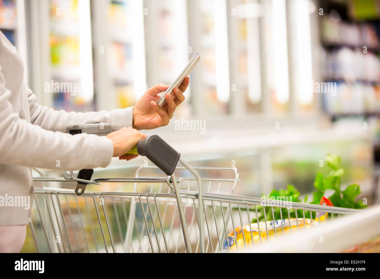 Female store cell phone close-up - Stock Image