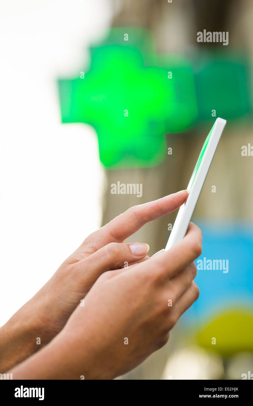 Female smart phone street outdoor sms message - Stock Image