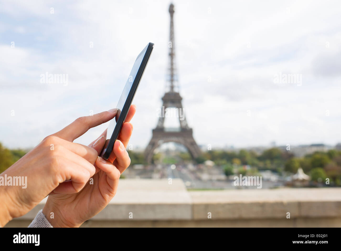 Close up of hands Female mobile phone Paris message sms e-mail - Stock Image