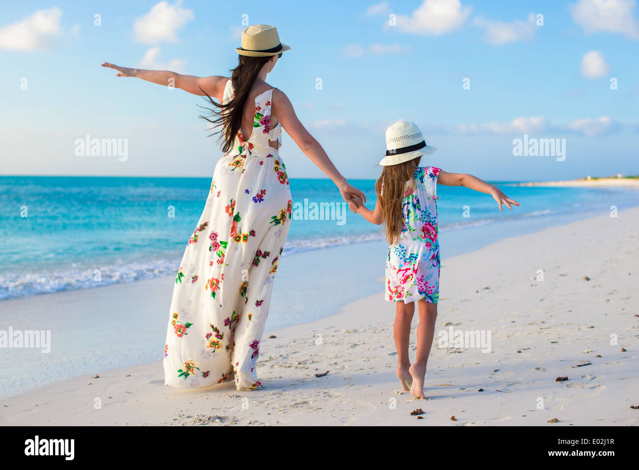 729c2bc1ce63d Beautiful mother and her adorable little daughter enjoy summer Stock ...