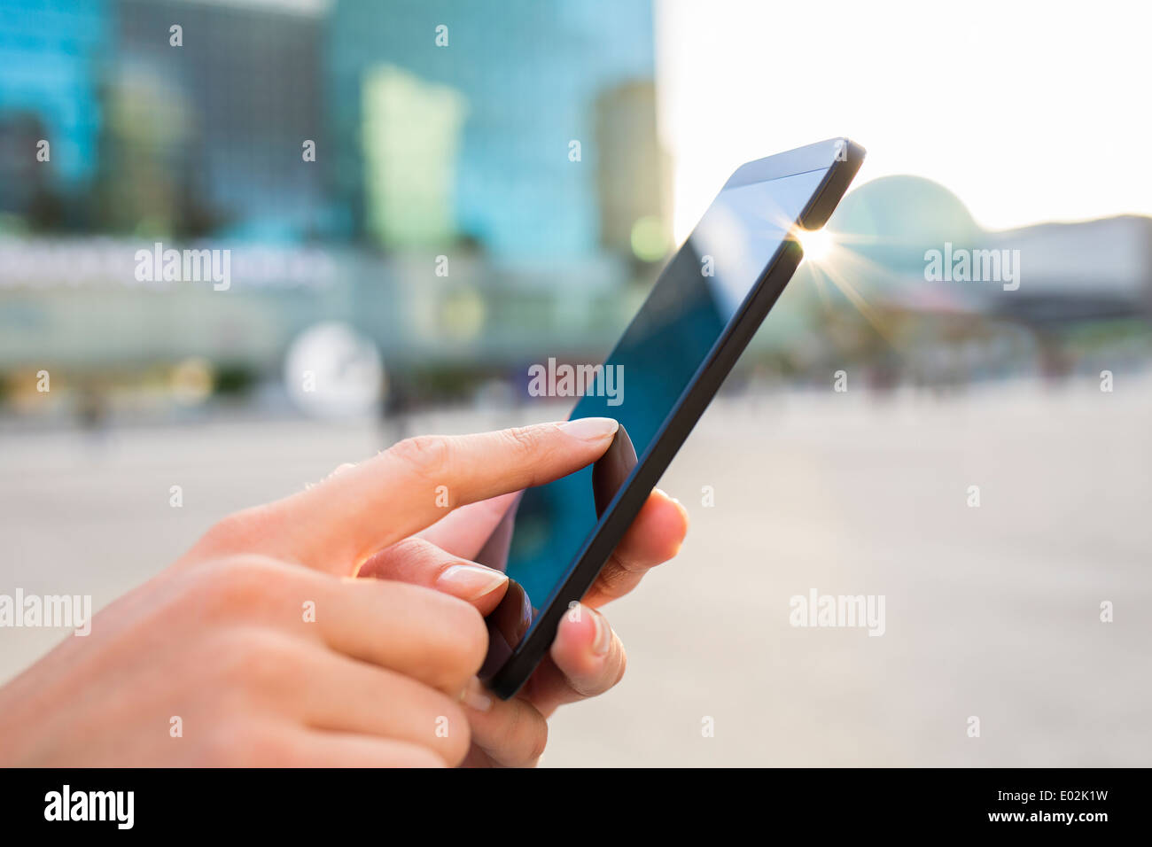 Female smartphone hand sun summer message sms e-mail - Stock Image