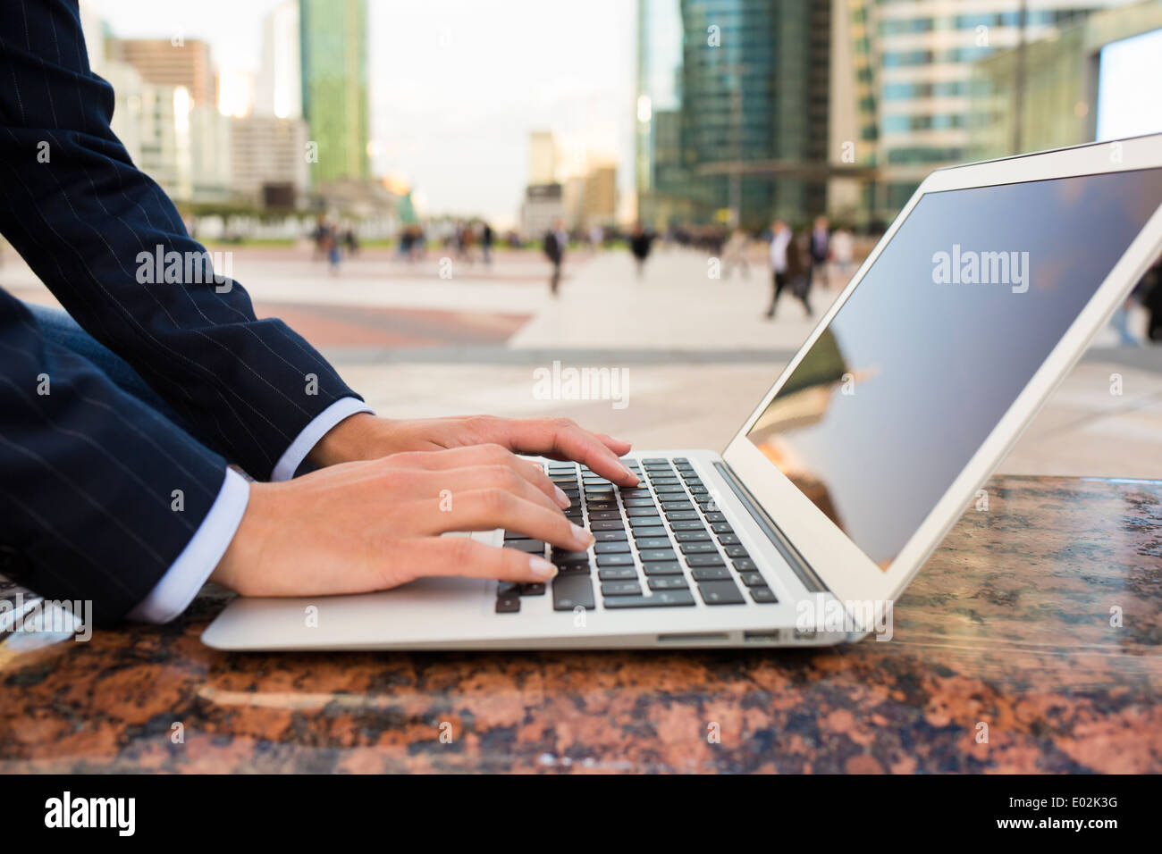 Female computer hand outdoor message sms e-mail - Stock Image