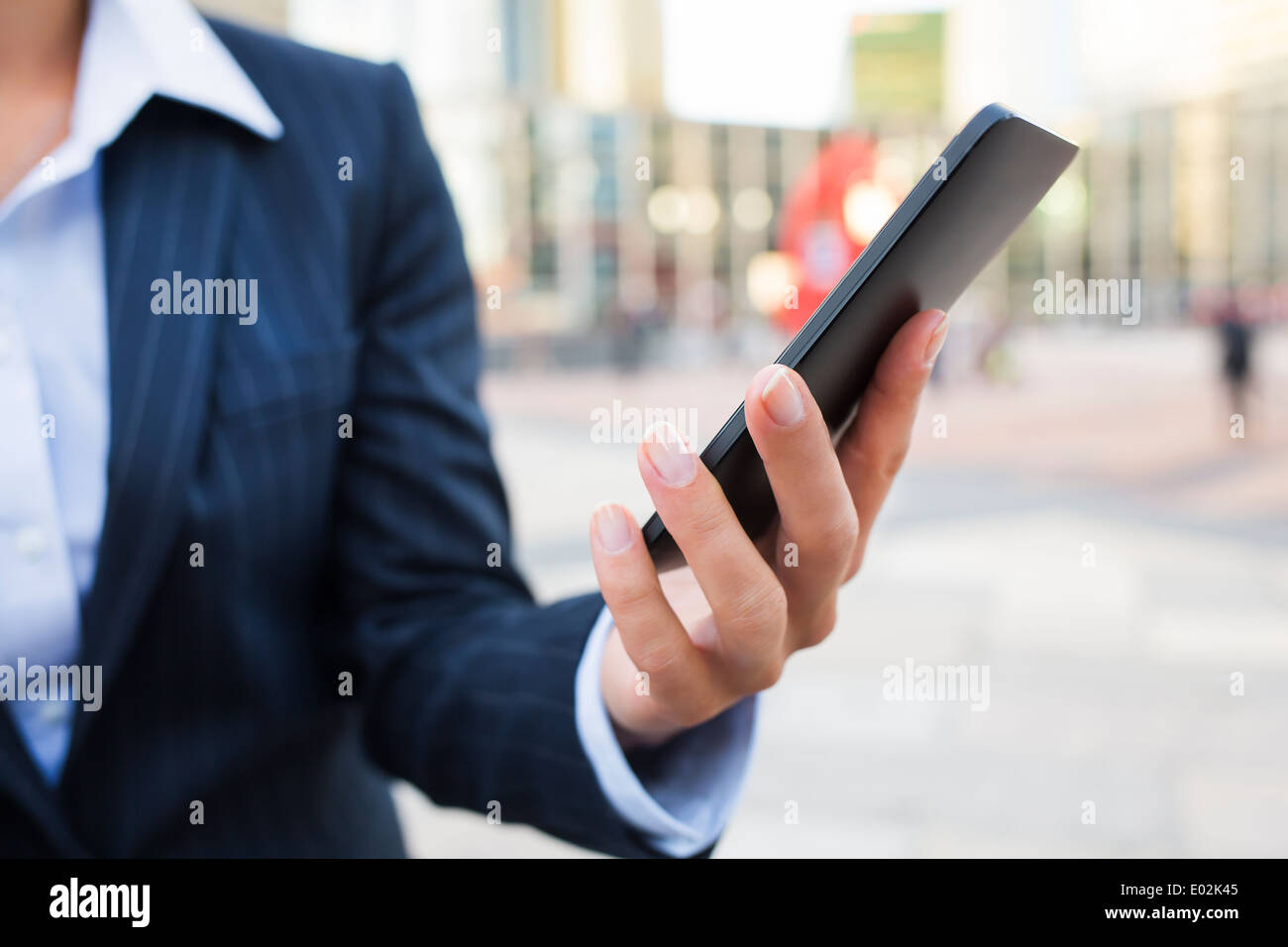 Female Mobile phone hand outdoor message sms e-mail - Stock Image