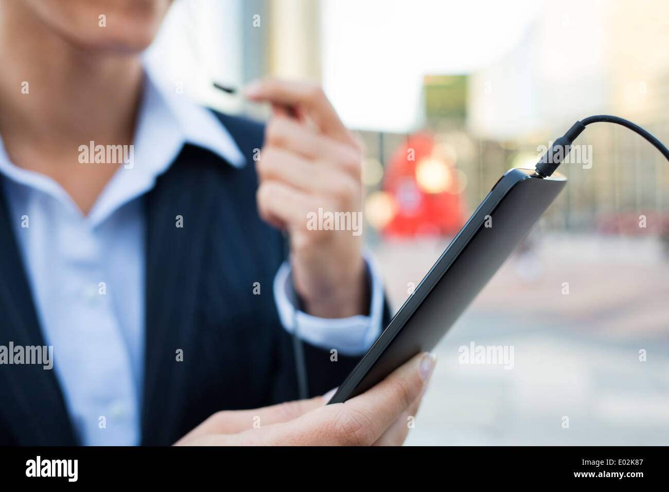 Female Mobile phone hand outdoor Building Stock Photo