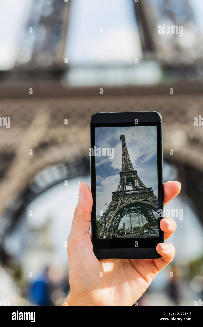 Female smart phone phtography travel France - Stock Image