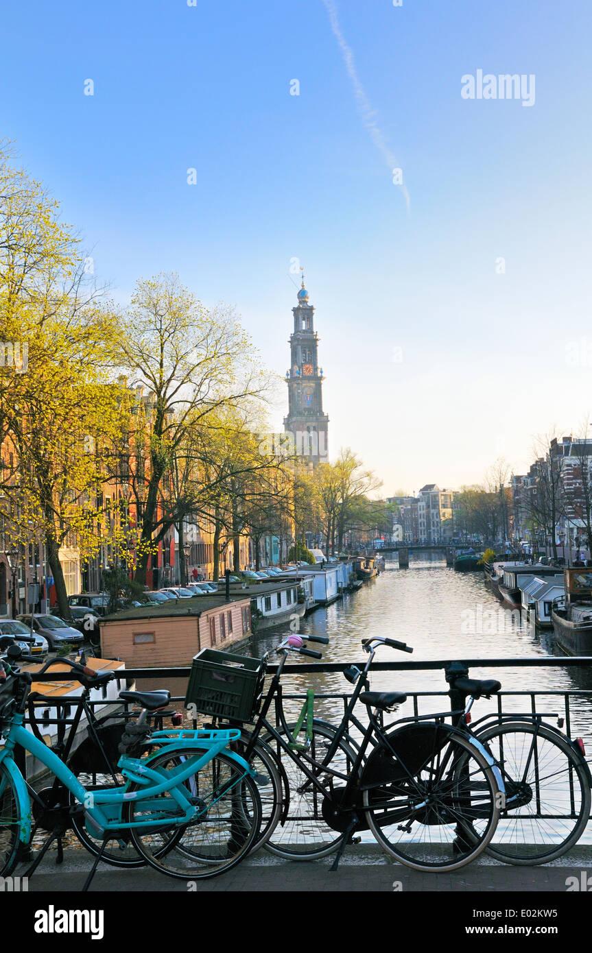 View down Prinsengracht towards the tower of Westerkerk, Jordaan, Amsterdam, Netherlands - Stock Image